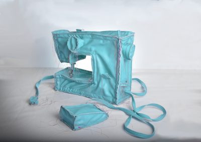 Margarita Cabrera, Sewing Machine (Blue Green), 2016, Vinyl, thread, copper wire and appliance parts, Installation dimensions vary
