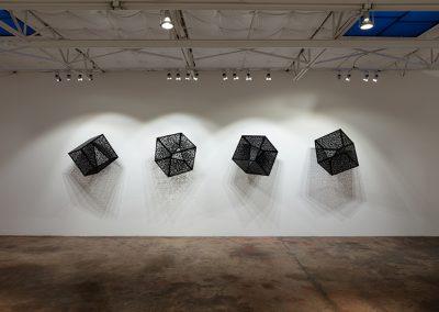 Anila Quayyum Agha, Itinerant Shadows, 2019, laser-cut, lacquered steel, 23 3/4 x 23 3/4 x 23 3/4 inches each