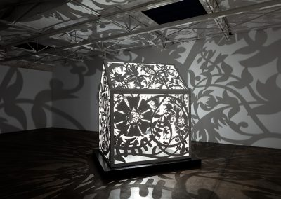 Anila Quayyum Agha, This is NOT a Refuge! (2), 2019, laser-cut, resin-coated aluminum with light bulb, 93 x 58 x 72 inches