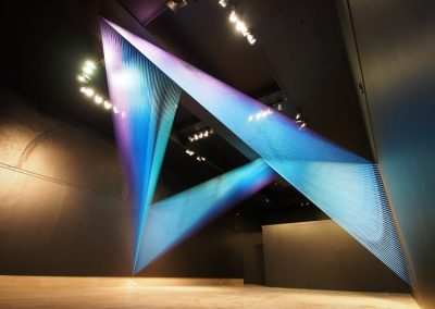 Plexus no. 31, 2015, Site-specific installation at Newark Museum, Thread, painted wood and hooks